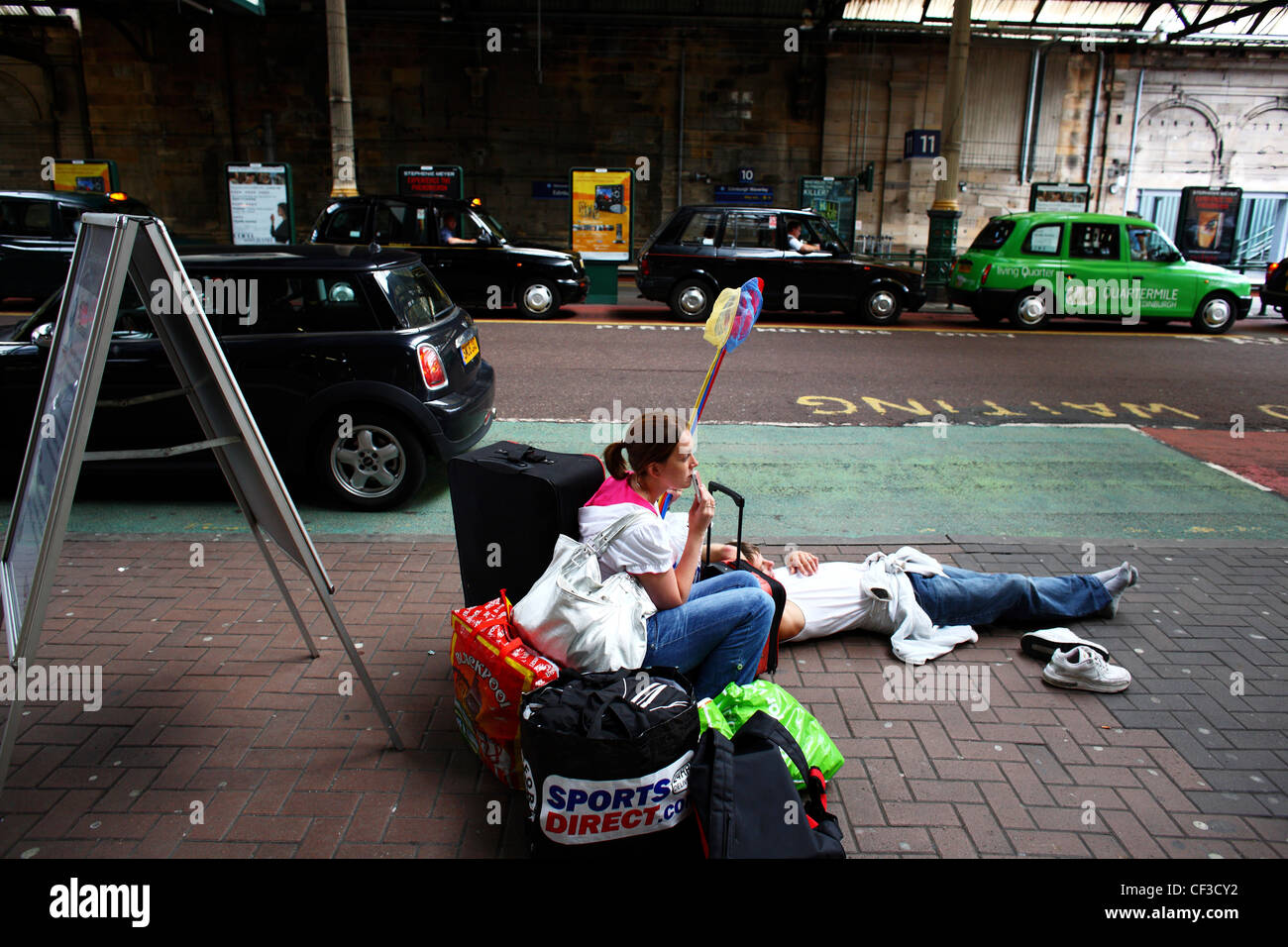 Travellers in transit outside Waverley Station. - Stock Image