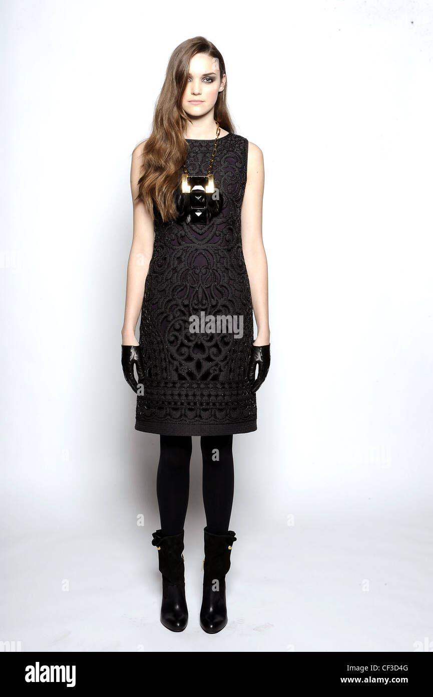 2b8a1df55196 Tory Burch New York Ready to Wear Autumn Winter Sleeveless textured black  pinafore dress, ankle boots and leather gloves