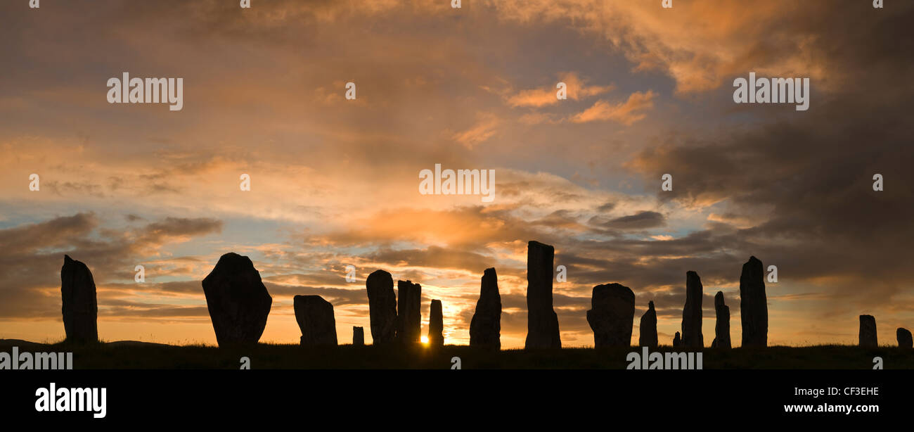 A silhouette of the ancient standing stones of Callanish 1 in the Isle of Lewis. - Stock Image