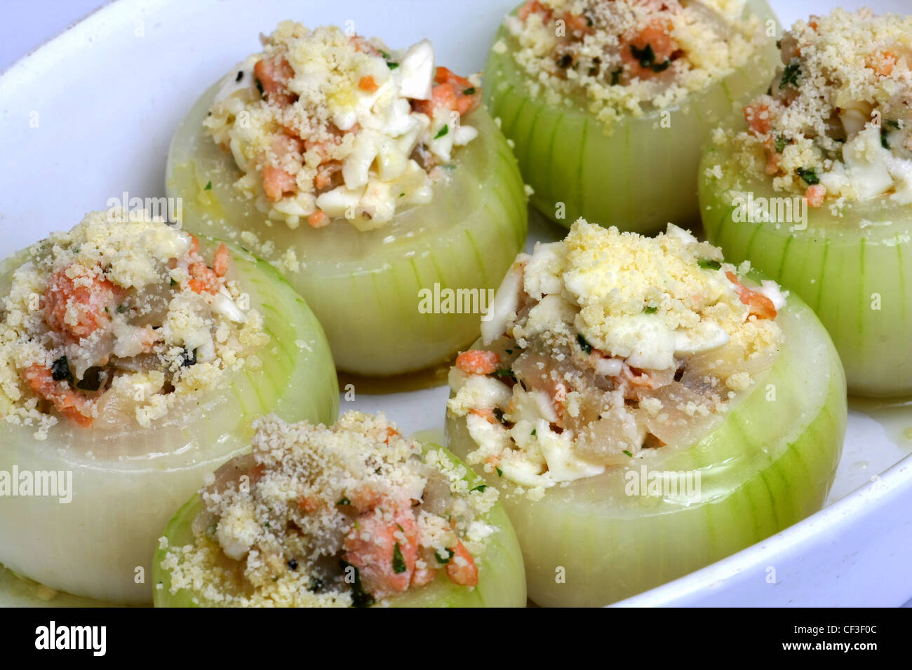ions Ingredients: medium onions, g smoked salmon (chopped), finely chopped mozzarella ball, tbps grated Parmesan - Stock Image