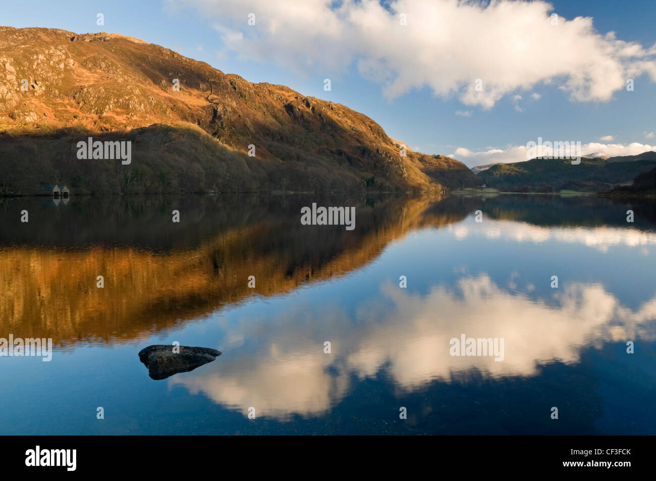The sky reflected in Llyn Dinas lake in the Nant Gwynant valley. - Stock Image