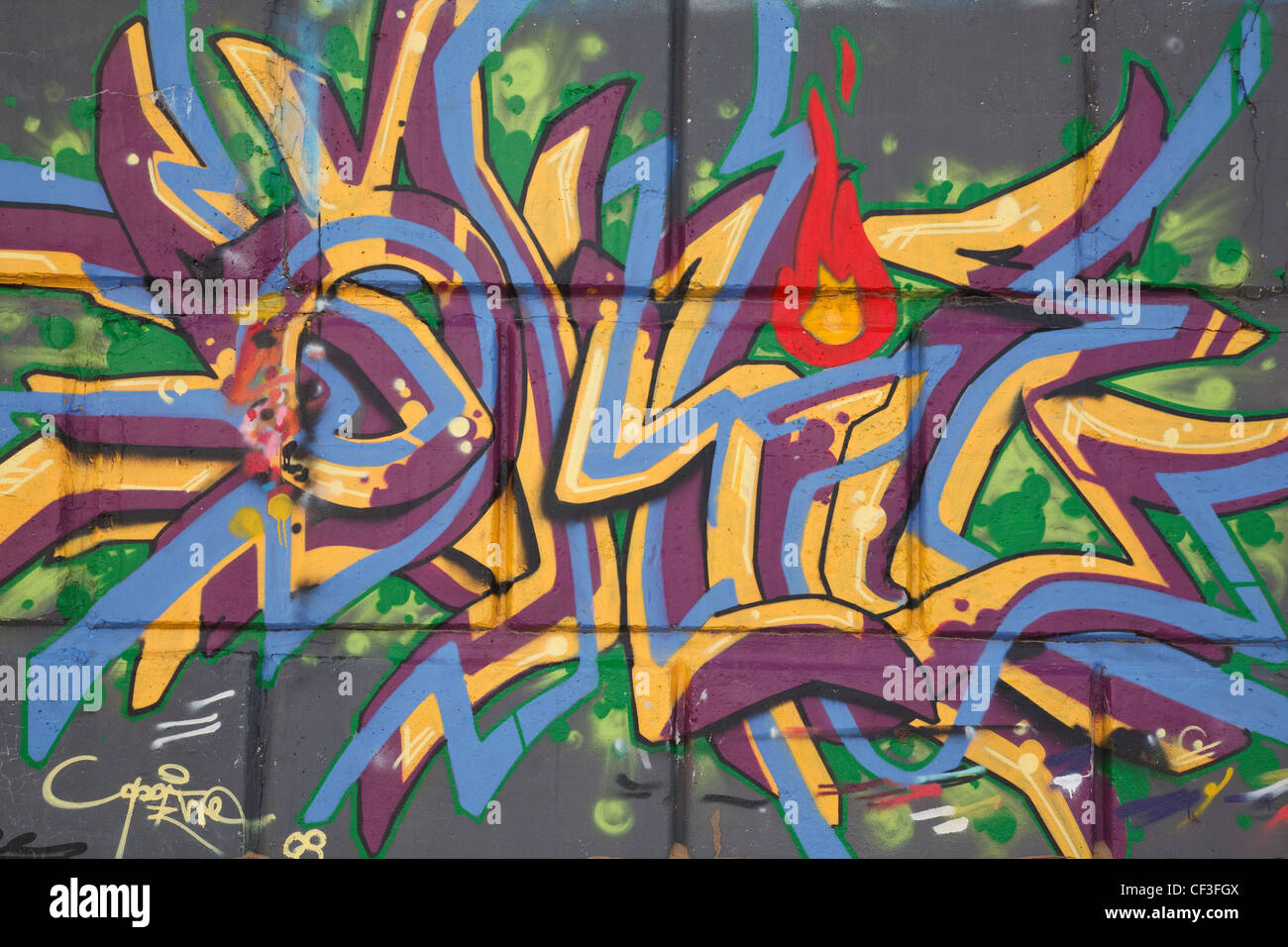 Bright graffiti on concrete wall abstract drawing street graphics