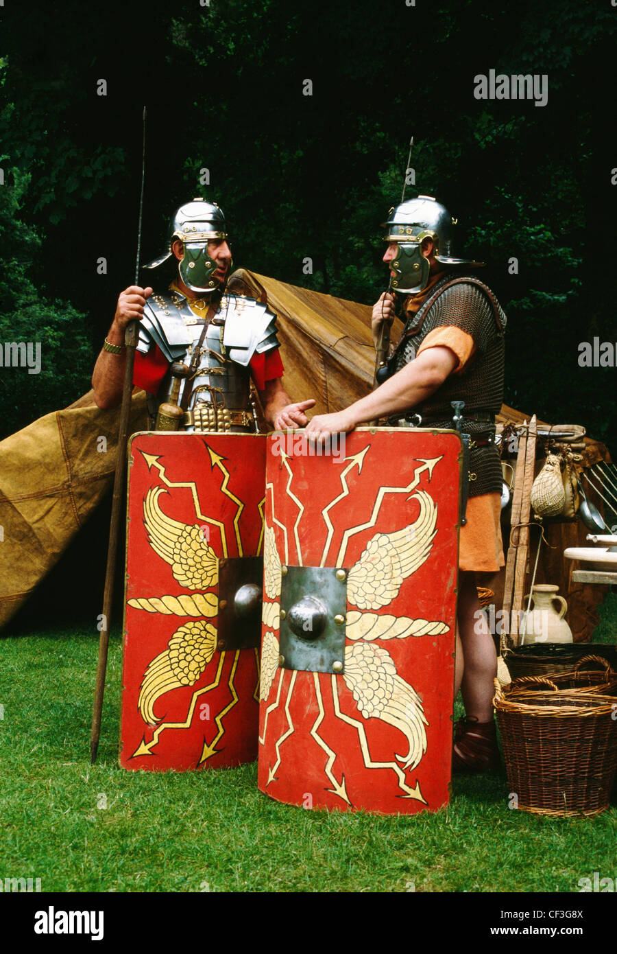 Two members of the Ermine Street Guard re-enactment society dressed as Roman legionaries standing outside their - Stock Image