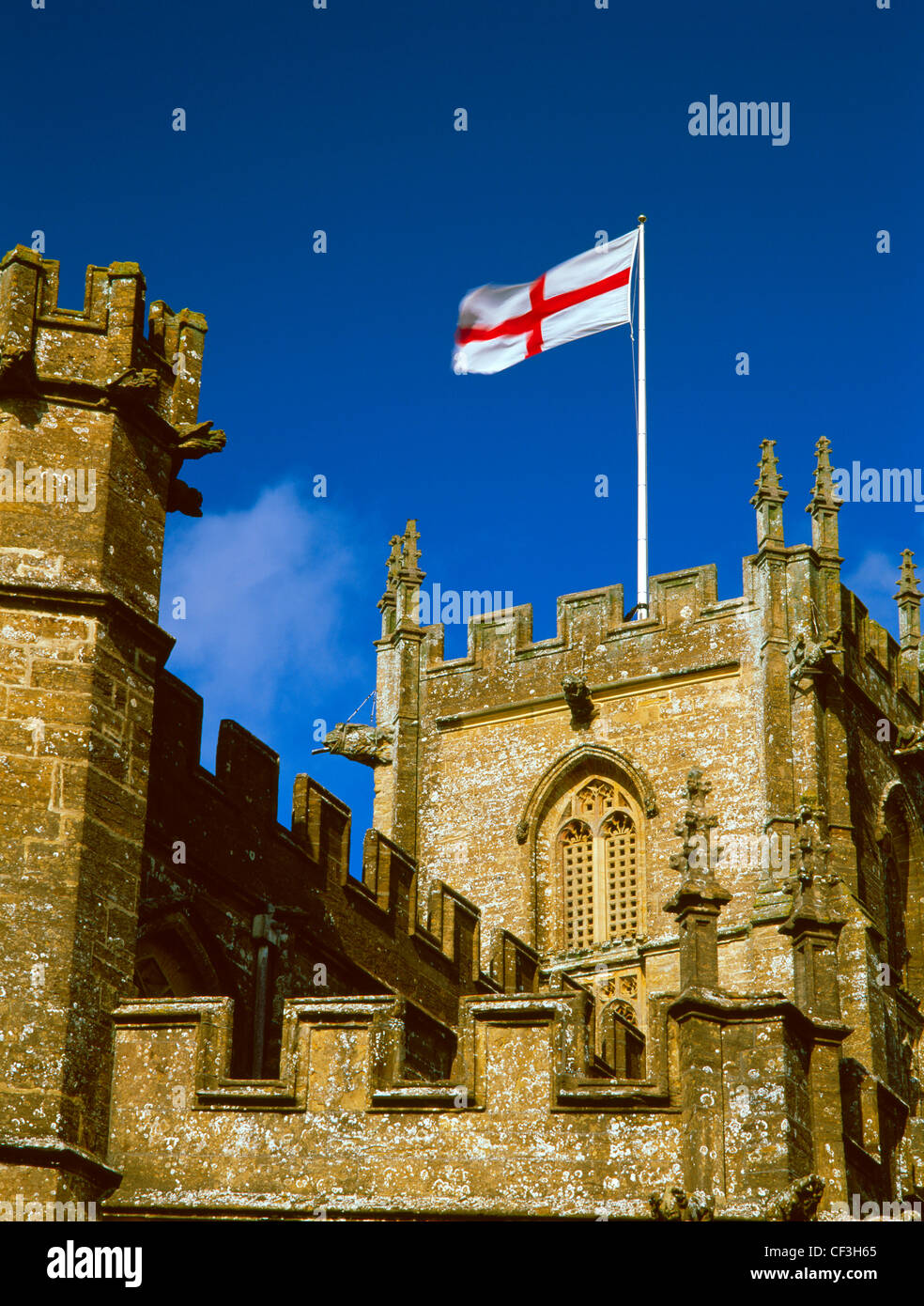The flag of St George flying from the tower of St Bartholomew's late Medieval church which was originally founded - Stock Image