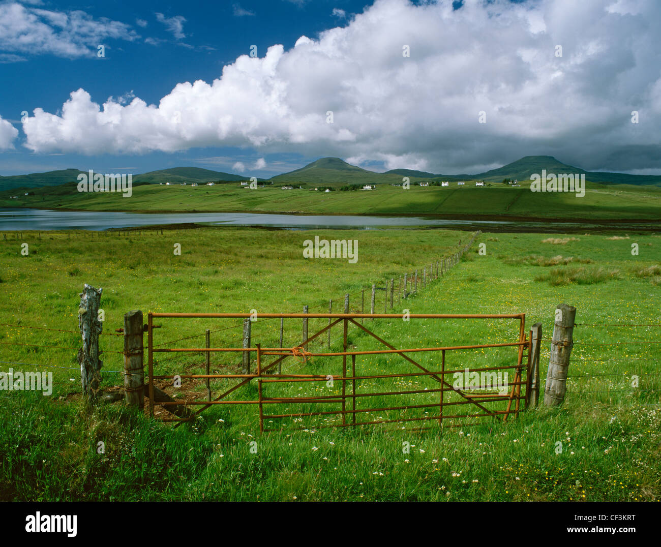 Looking SW from near Vatten, across Pool Roag and Roag crofting village to two distinctive flat-topped and stepped - Stock Image