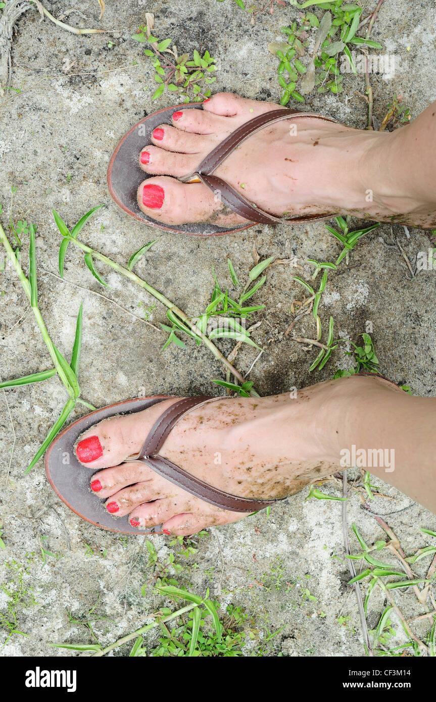 Mature mexican feet in flip flops