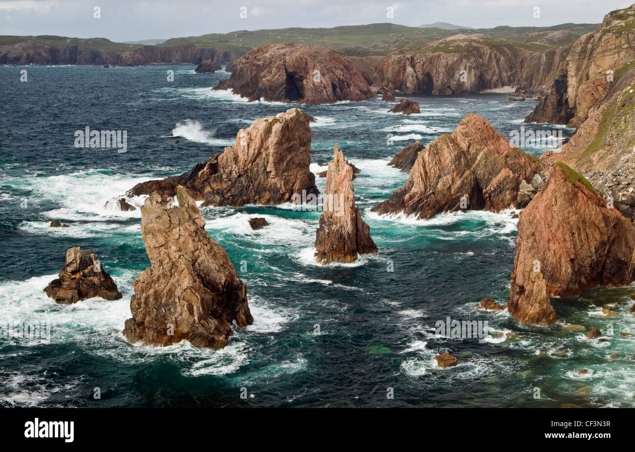 Sea stacks off the western coast of the Isle of Lewis in Scotland. - Stock Image