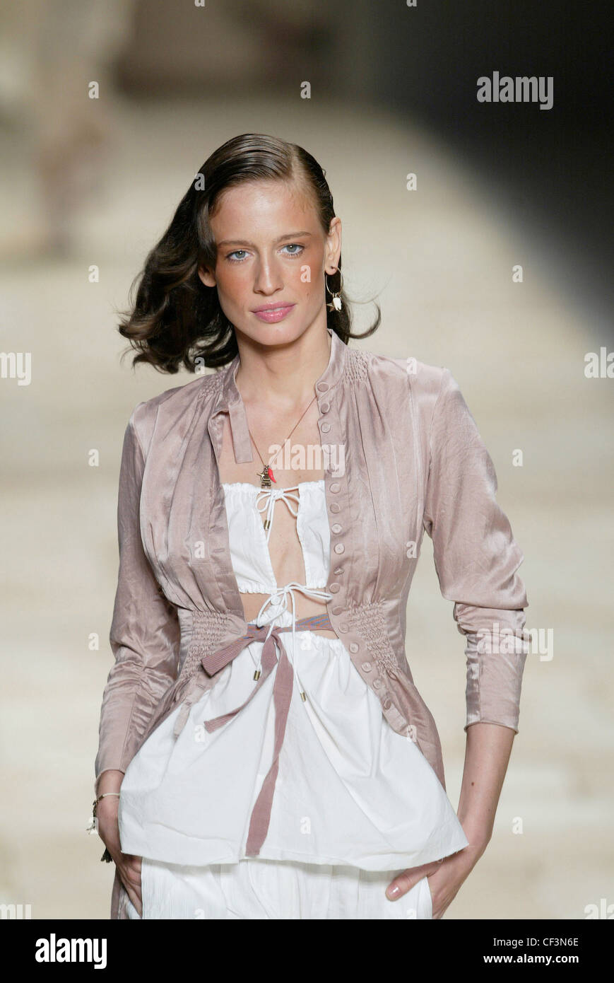20fec4c0d7aa Givenchy Paris Ready to Wear Spring Summer Model shoulder length brunette  hair dangly earring and necklace