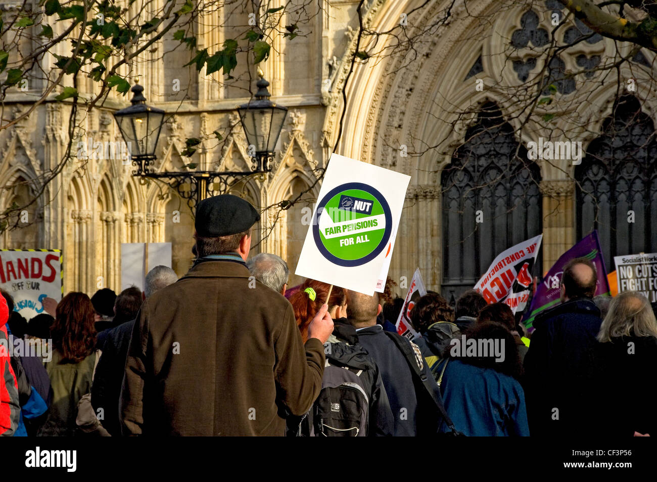 Public sector workers demonstrating against pension reforms outside the York Minster. - Stock Image