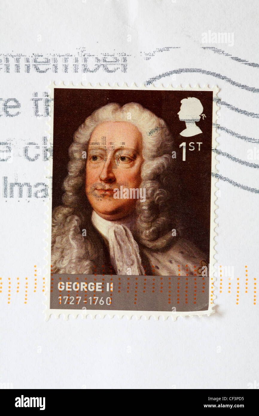 1st class stamp showing George II 1727-1760 stuck on white envelope - Stock Image