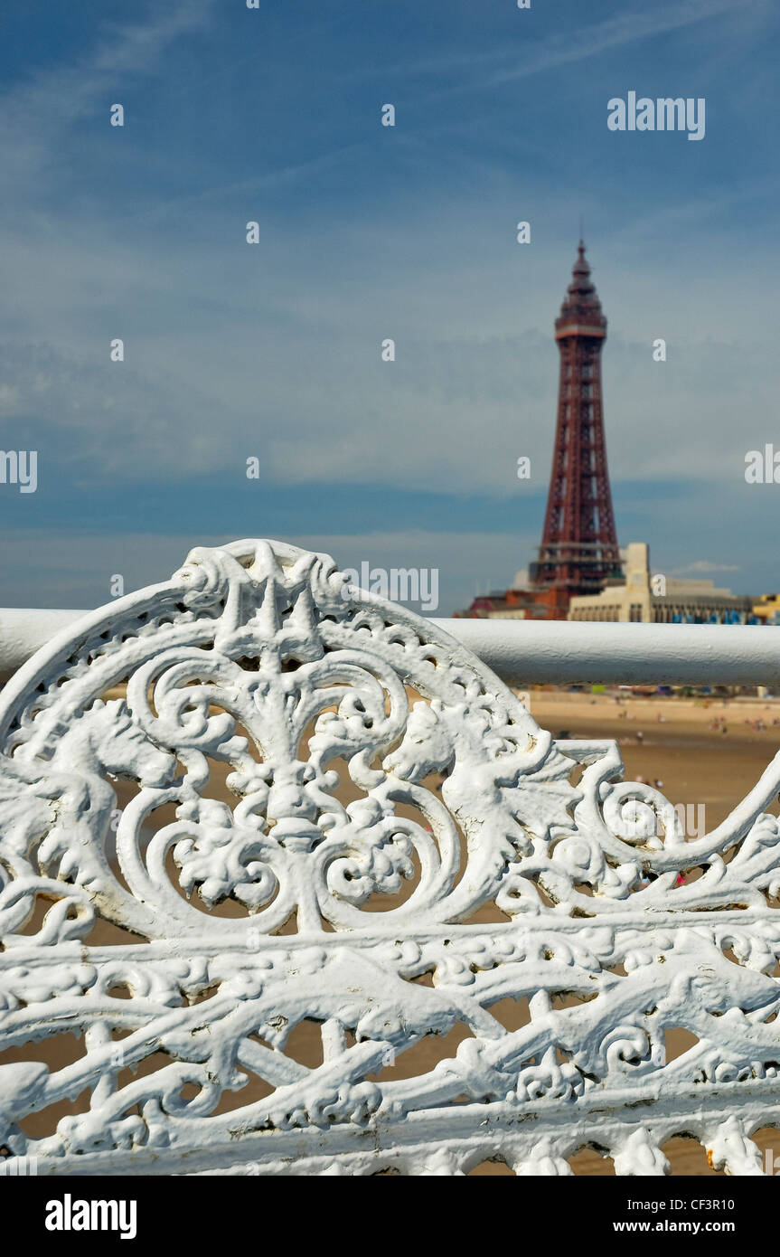 Ornate seating on central pier with Blackpool Tower in the background. Stock Photo