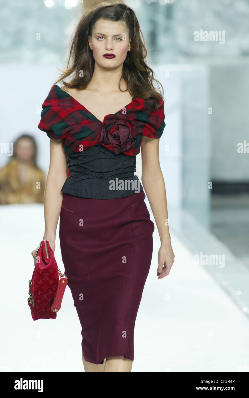 ae6fe117de94c9 Model long brunette hair wearing black off the shoulder top red and green  tartan sleeves and