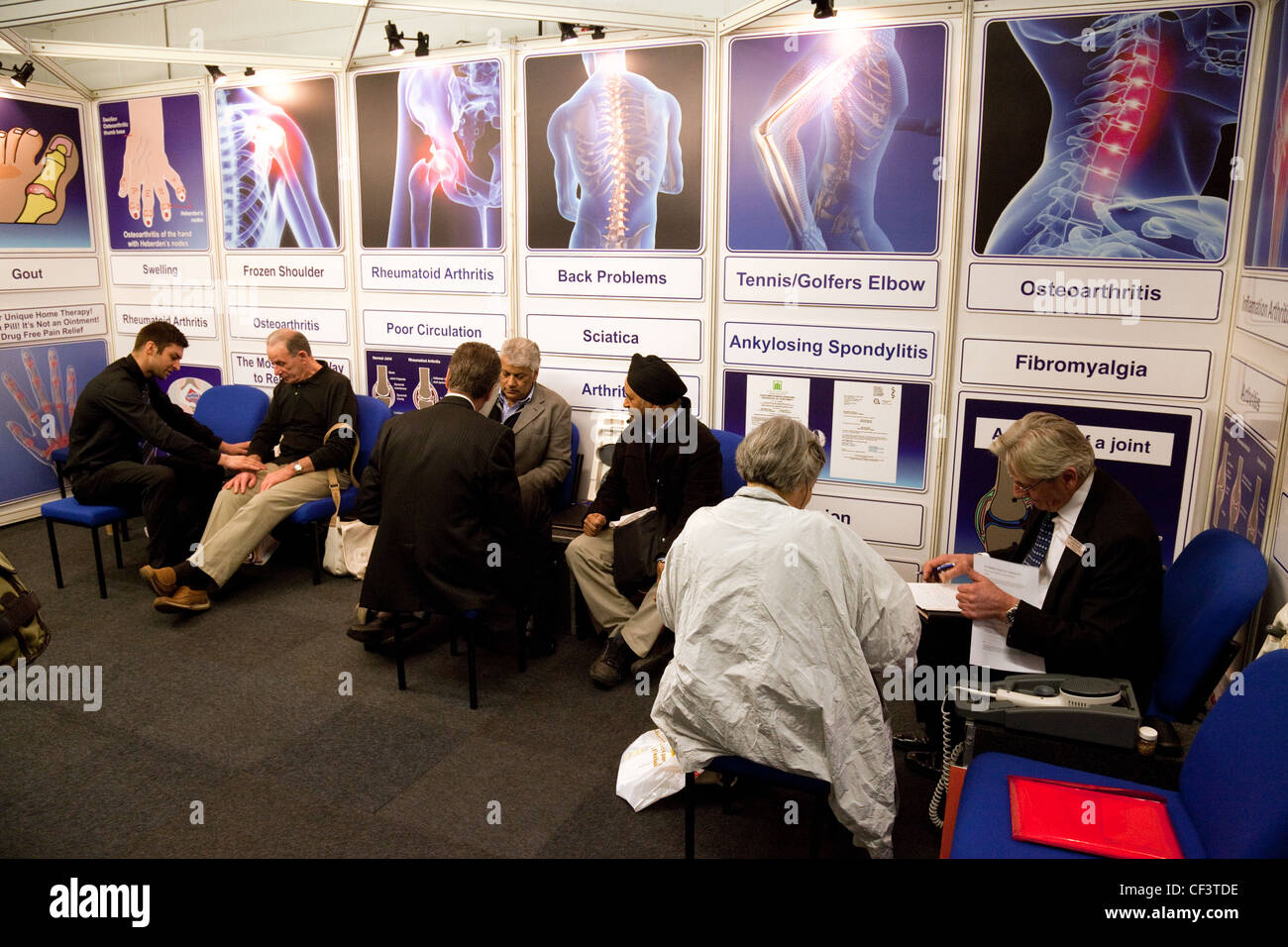 Patients getting advice about arthritis conditions from specialists at the Back Pain show london UK - Stock Image