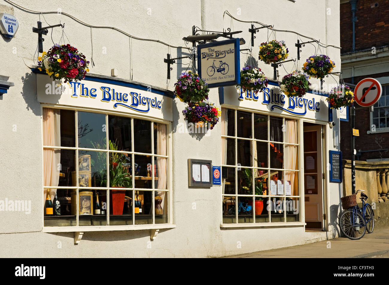 A blue bicycle outside the Blue Bicycle Restaurant in Fossgate. - Stock Image