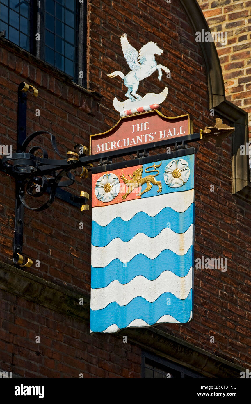 Sign above the entrance to the Merchant Adventurers' Hall in Fossgate, built in the 14th century as a place - Stock Image