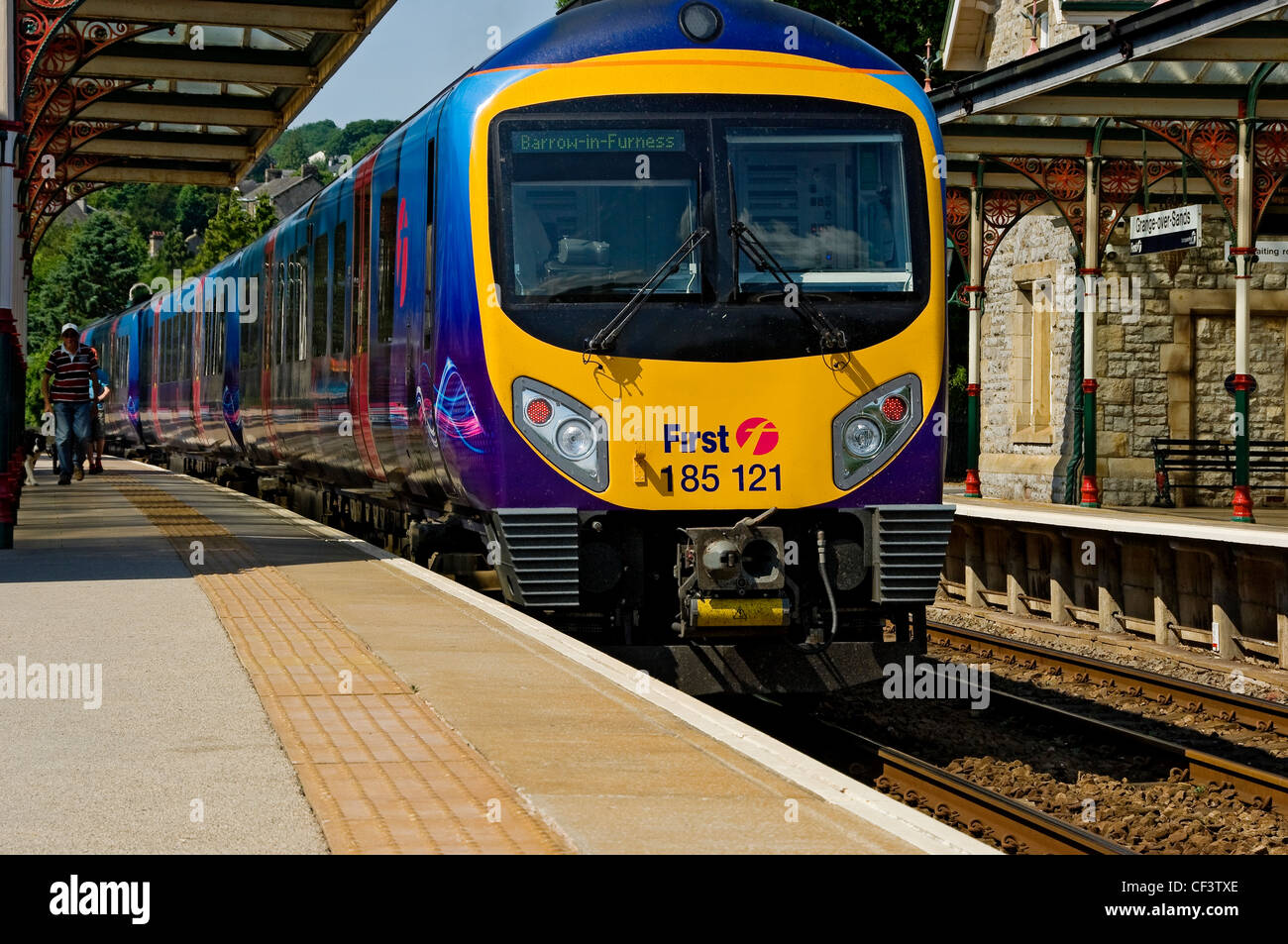 A First TransPennine Express train waiting to depart Grange-over-Sands railway station. - Stock Image