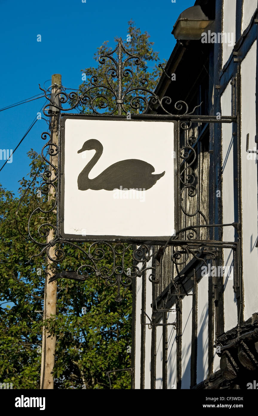 Hanging sign outside the Black Swan pub in Peasholme Green. The first record of the building being used as a pub - Stock Image