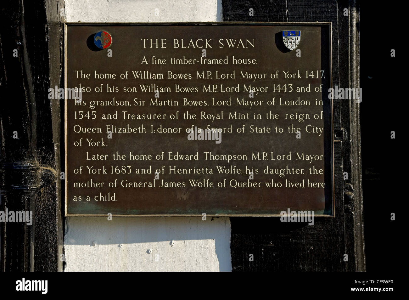 Bronze plaque on the wall of the Black Swan pub in Peasholme Green. - Stock Image