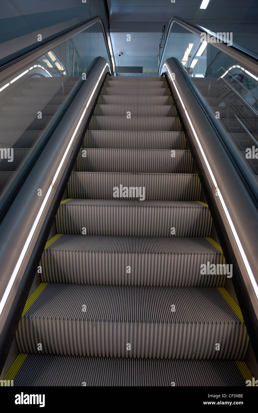 Looking up an escalator - Stock Image