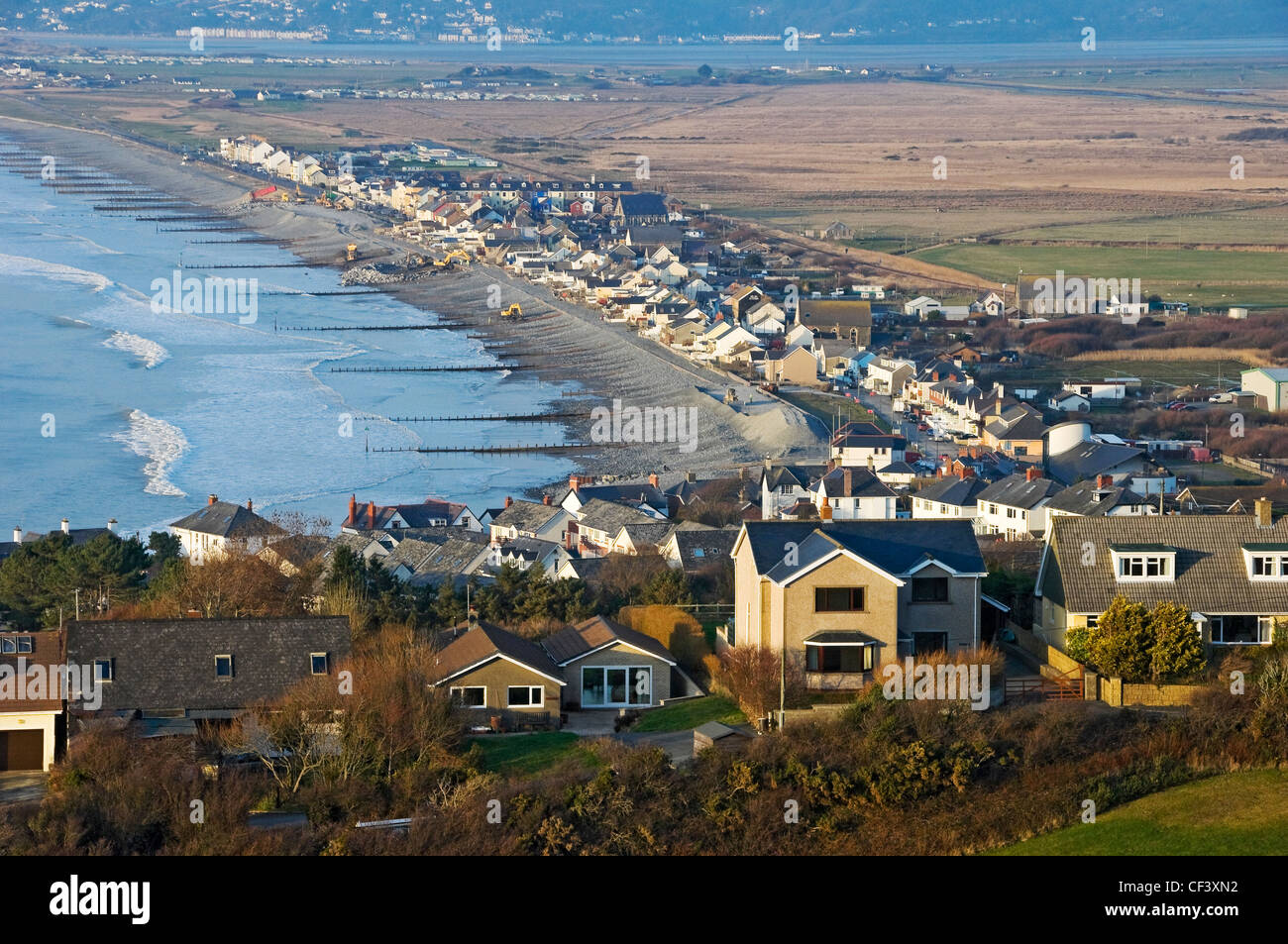View over the coastal village of Borth with the River Dyfi estuary in the background. - Stock Image