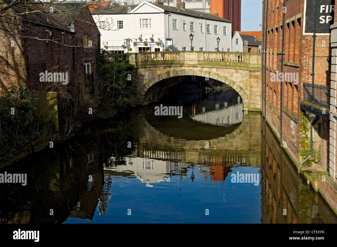 Foss Bridge, a 19th century Georgian gritstone bridge over the River Foss. - Stock Image