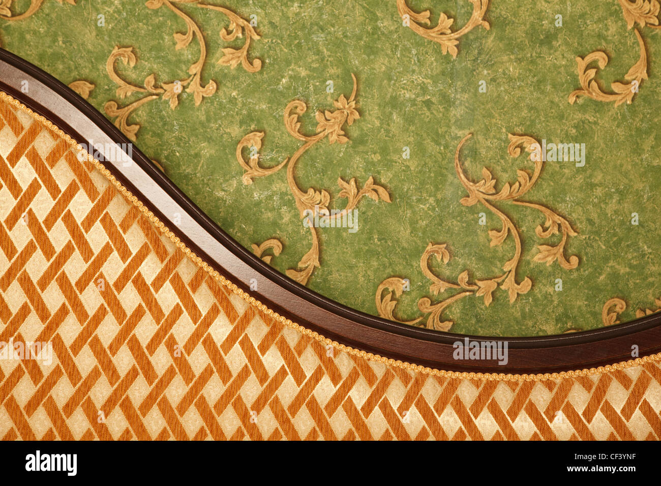Fragment of sofa against green wall. Interior in retro style. Horizontal format. - Stock Image