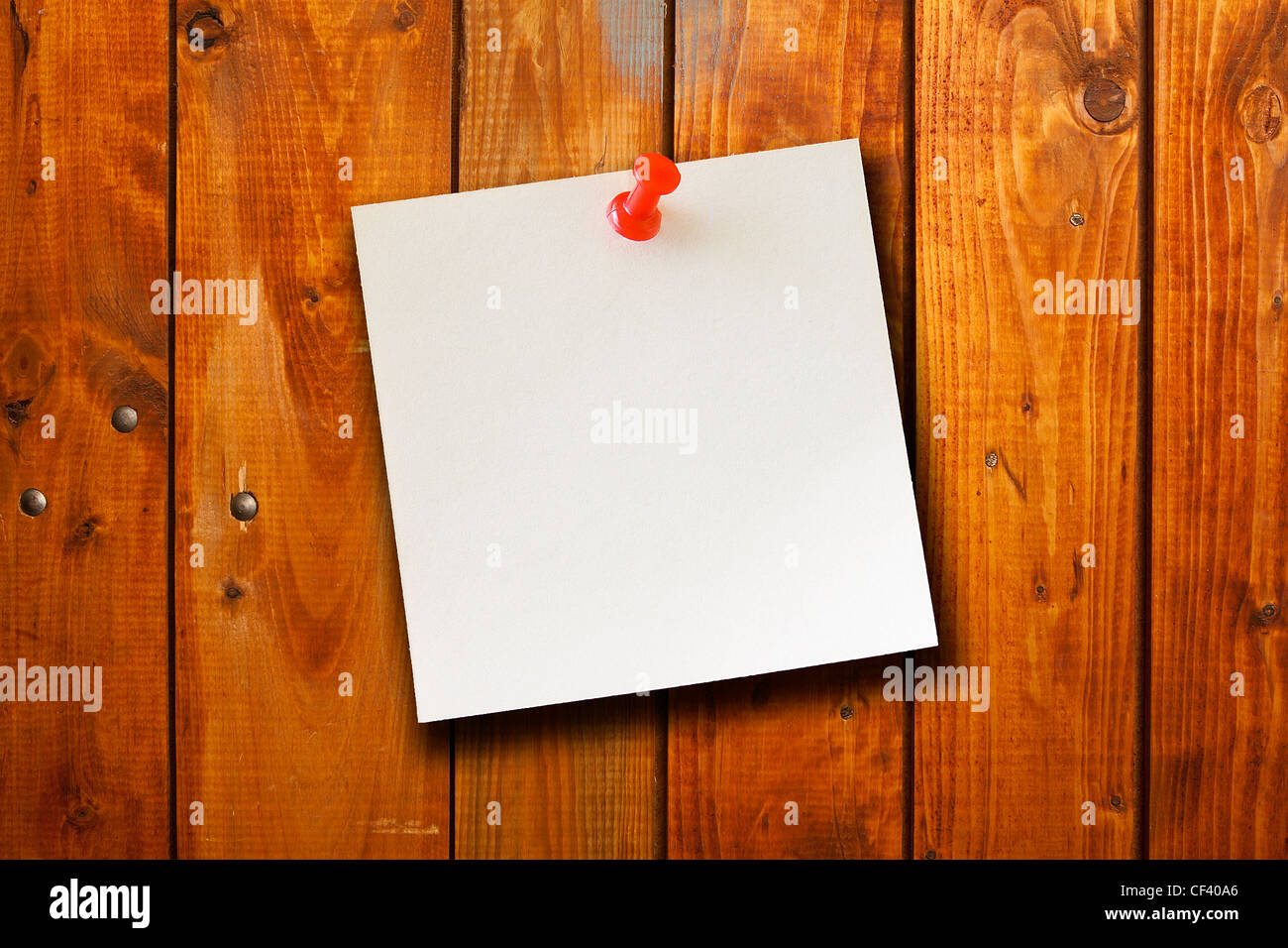 the blank paper note on wood board background - Stock Image