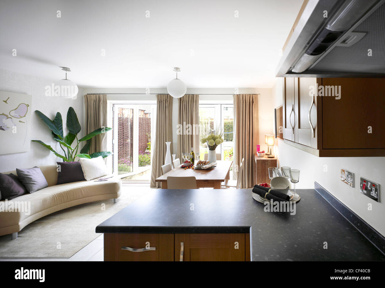 Open plan view of kitchen, dinning area and lounge Stock Photo ...