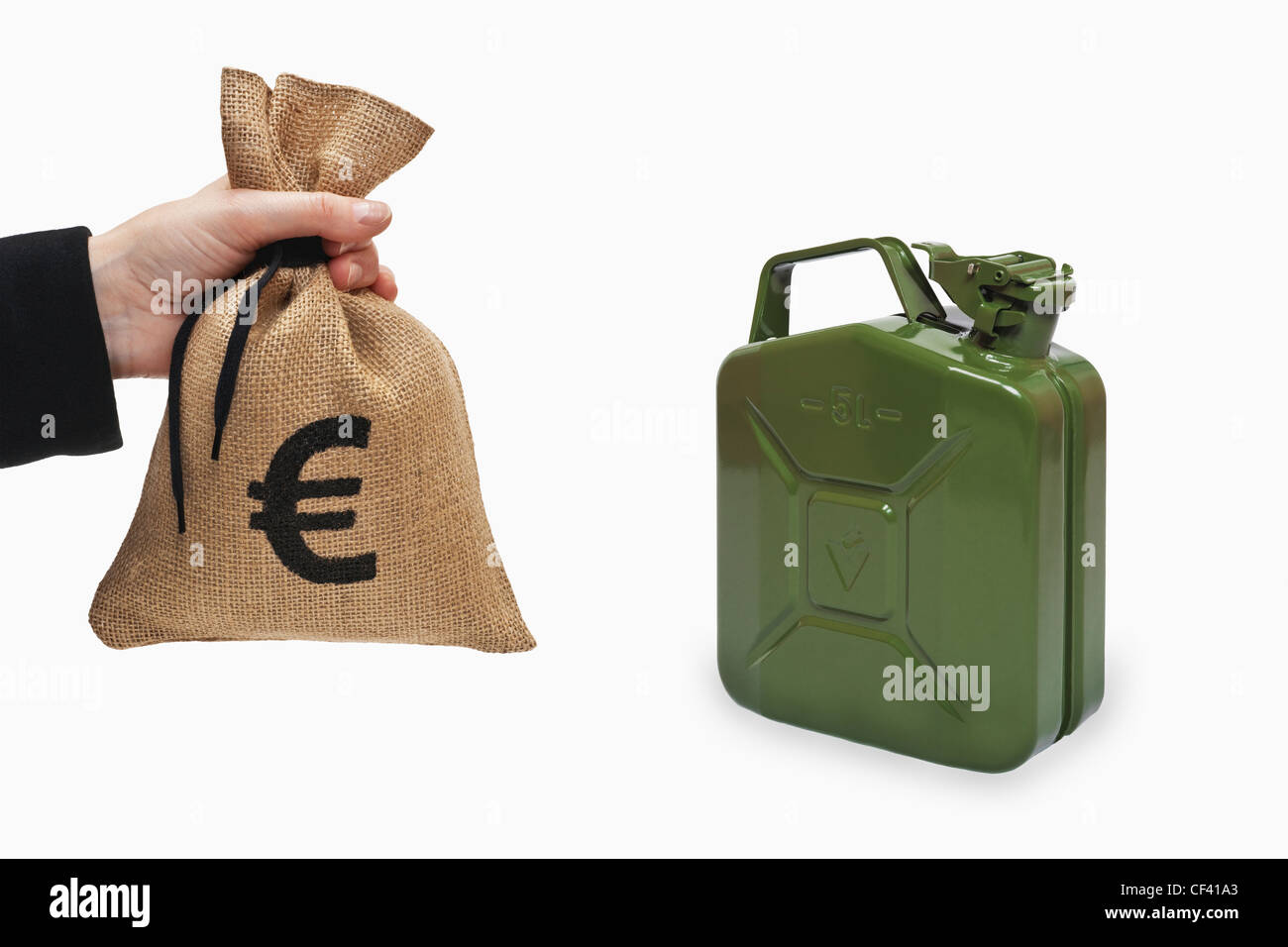 A money bag with a Euro currency sign is held in the hand. Near by is a green 5 liters gasoline canister of metal. - Stock Image