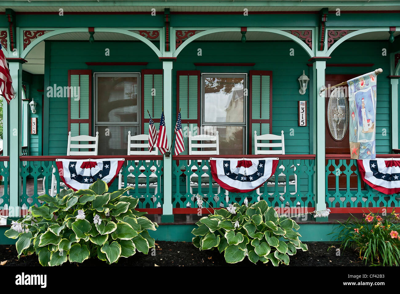 Victorian house and gardens, Cape May, NJ, USA - Stock Image