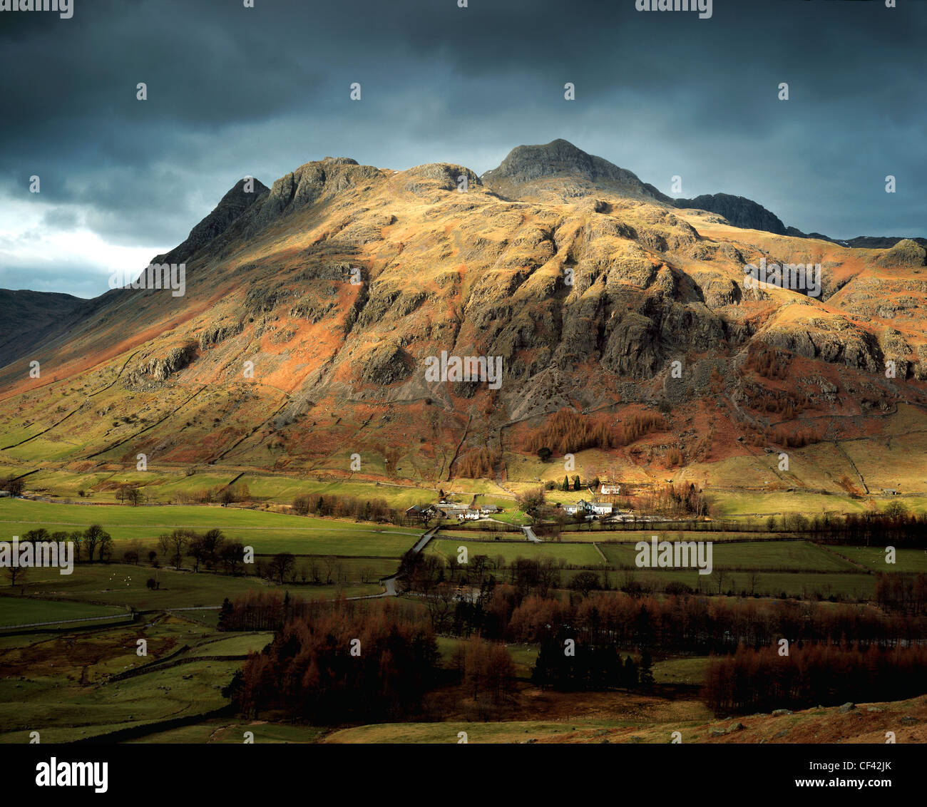 Looking across the remote and rugged Langdale Valley in the Lake District. - Stock Image