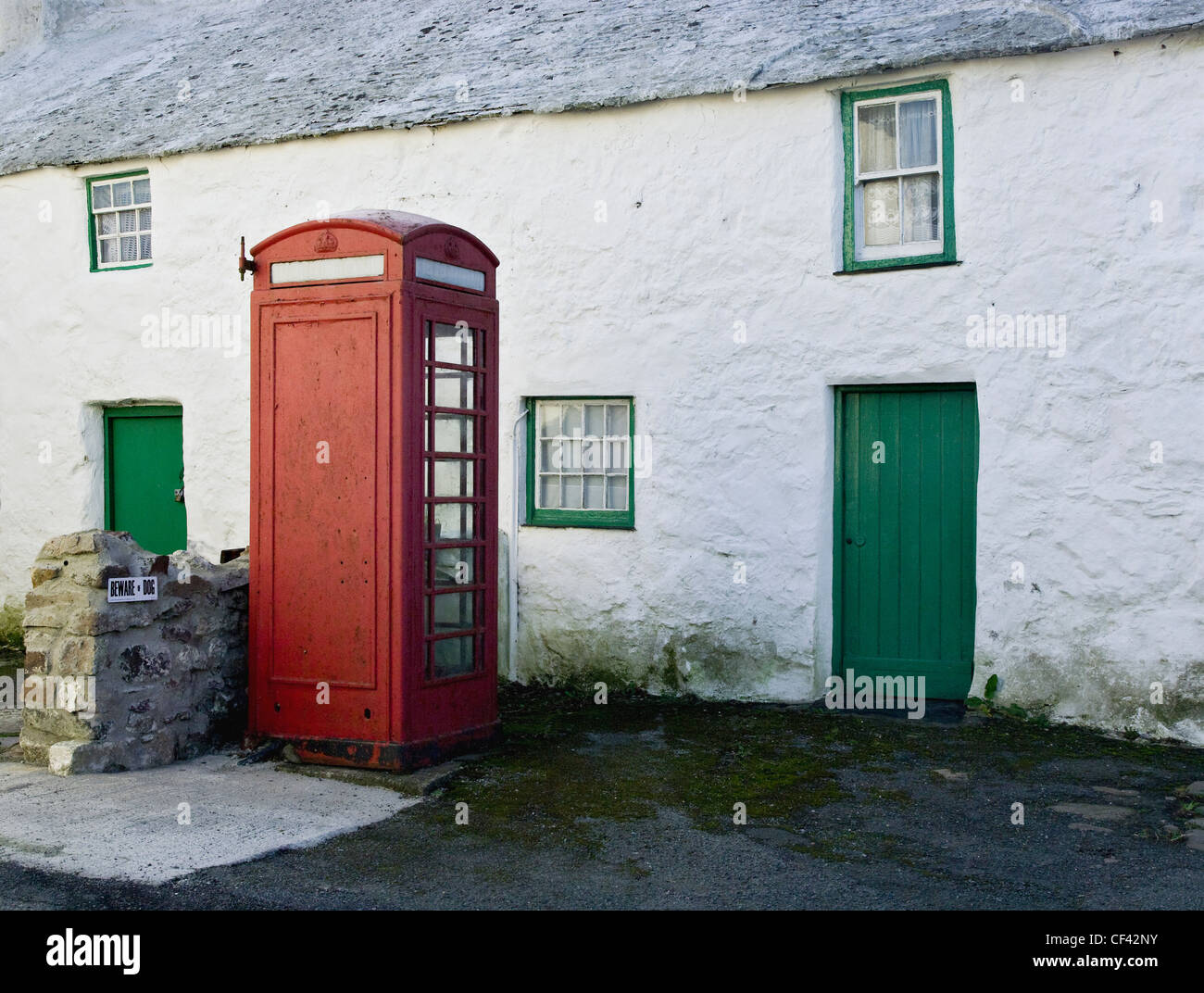 A public telephone box outside a remote farmhouse, previously a sub post office in Maenaddwyn. - Stock Image