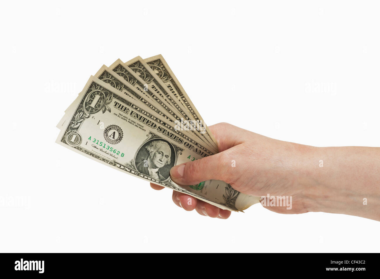 Five 1 U.S. Dollar bills are held in the hand, white background - Stock Image