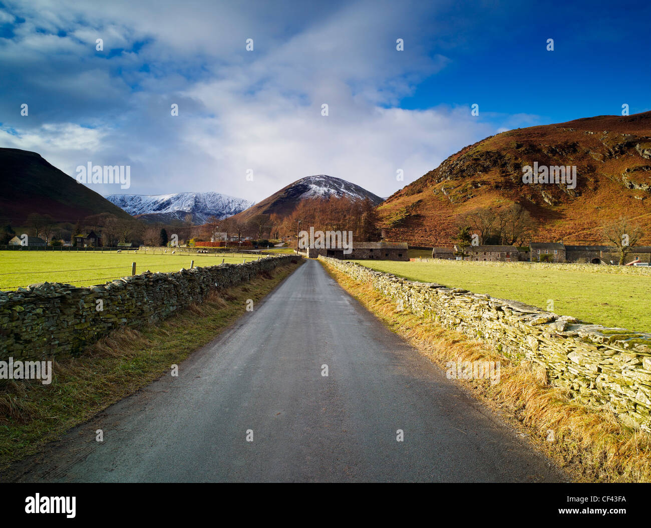 Looking along a quiet lane towards the remote Cumbrian village of Mungrisdale in the Lake District. Stock Photo