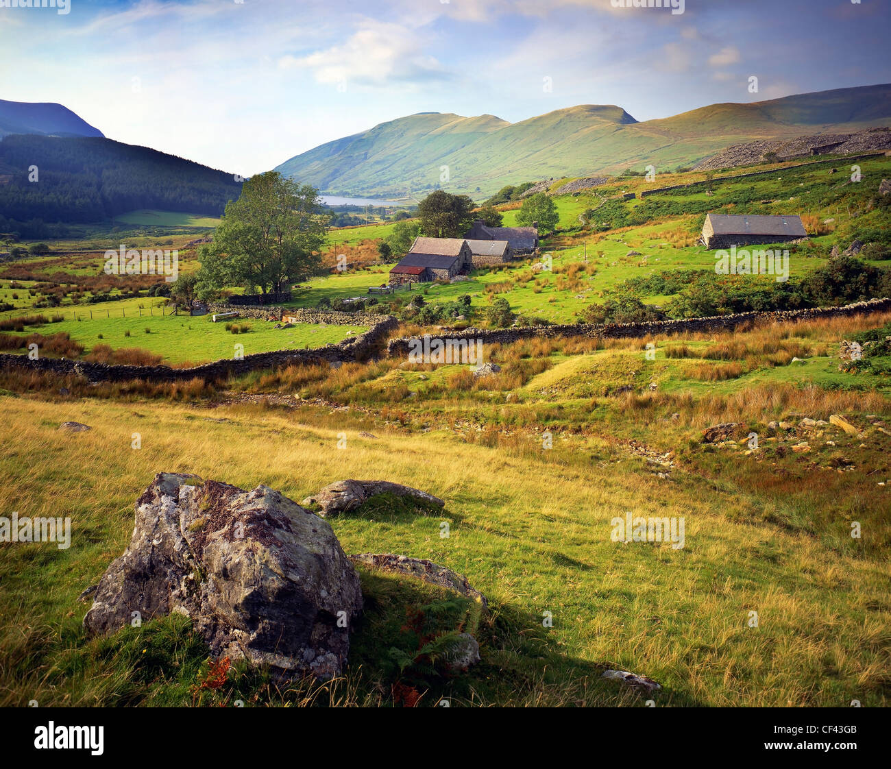 Looking west across farmland on the lower slopes of the Snowdonia mountains. - Stock Image