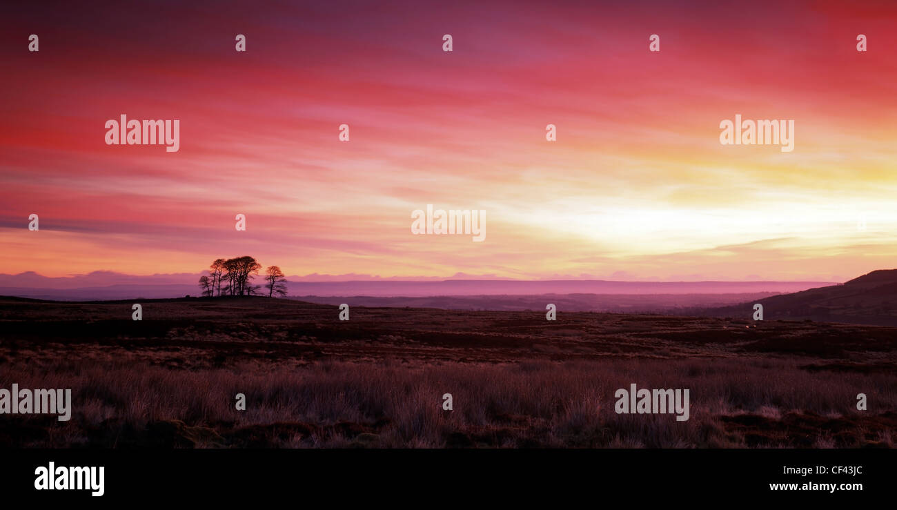 Beautiful red sky at daybreak over the North Yorkshire Moors. - Stock Image