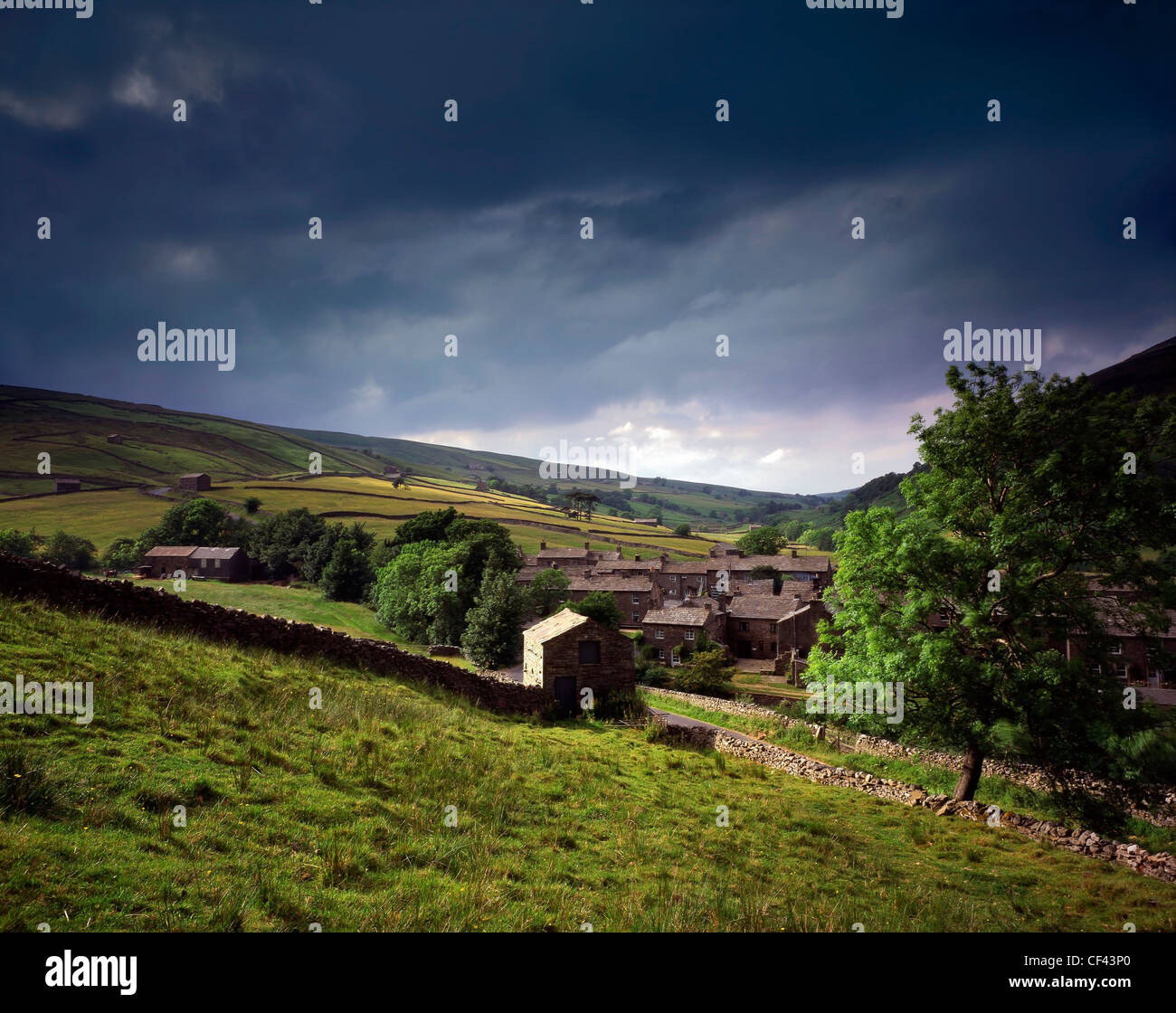 The small rural village of Thwaite in the Yorkshire Dales. - Stock Image