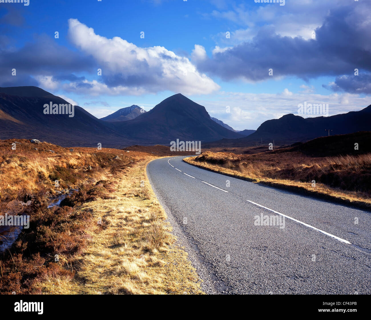 A road leading towards the Cuillin mountains on the Isle of Skye. - Stock Image