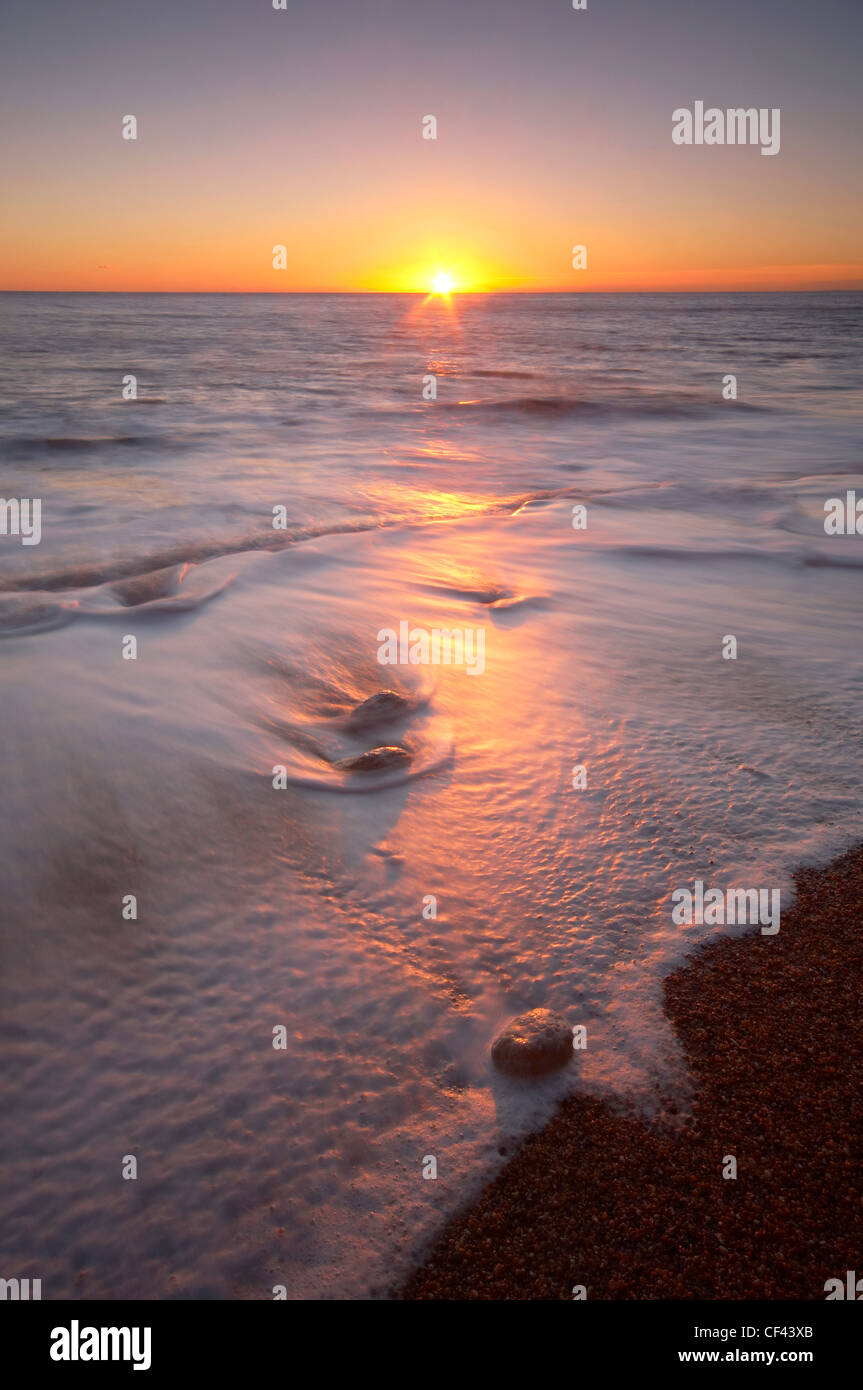 Atmospheric sunset over the jurassic  coast. - Stock Image