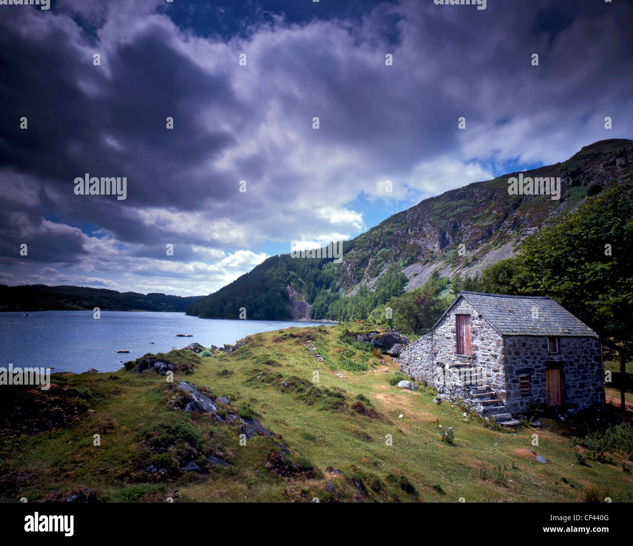 View across Llyn Geirionydd, a remote lake in Snowdonia as storm clouds gather overhead. - Stock Image