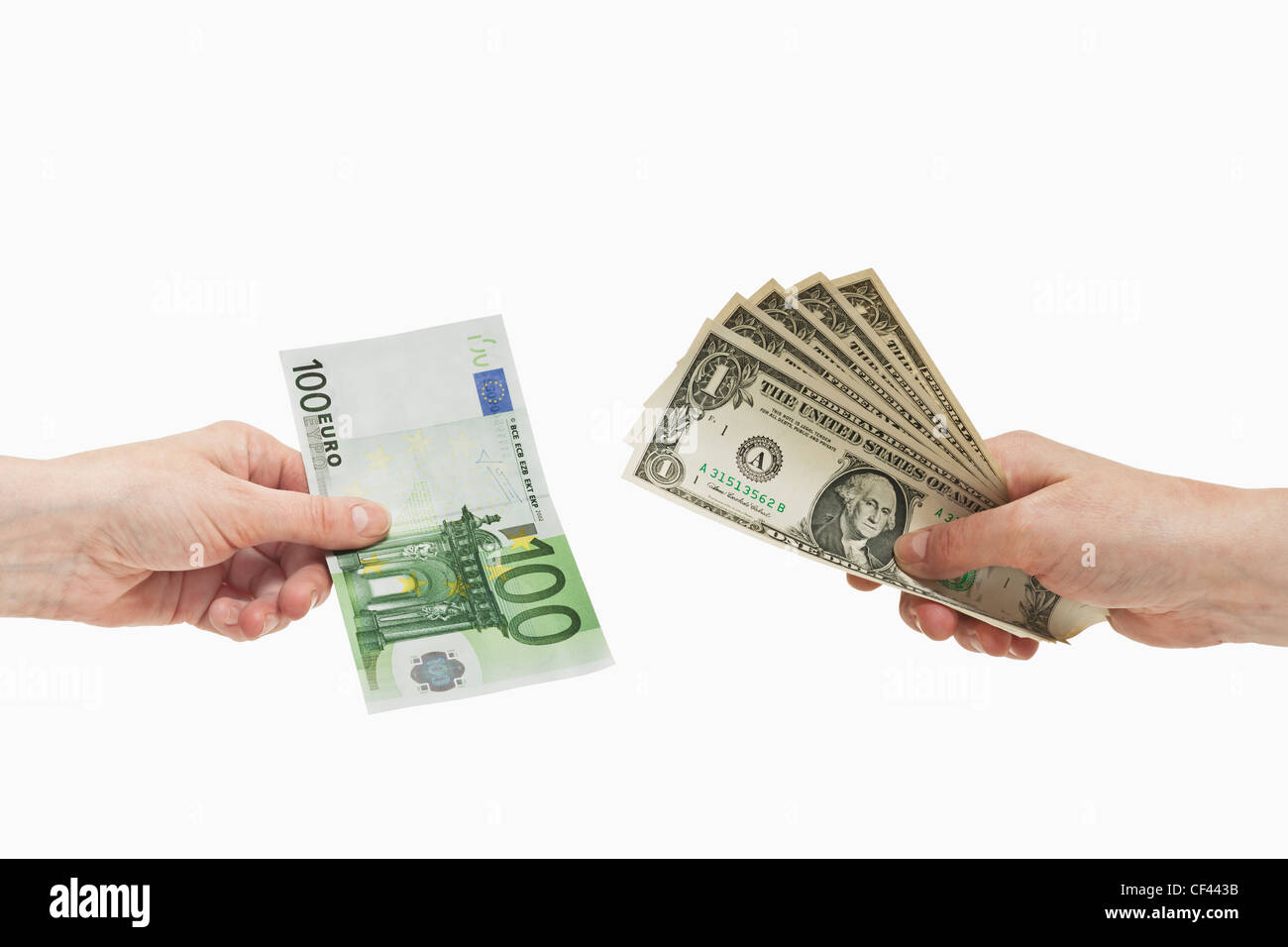 Five 1 U.S. Dollar bills are held in the hand. At the other side a 100 Euro bill is held in the hand, background Stock Photo