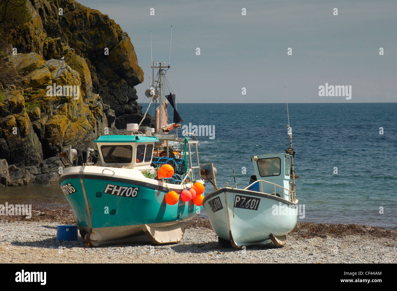 Fishing trawlers on the beach at Cadgwith Harbour. - Stock Image