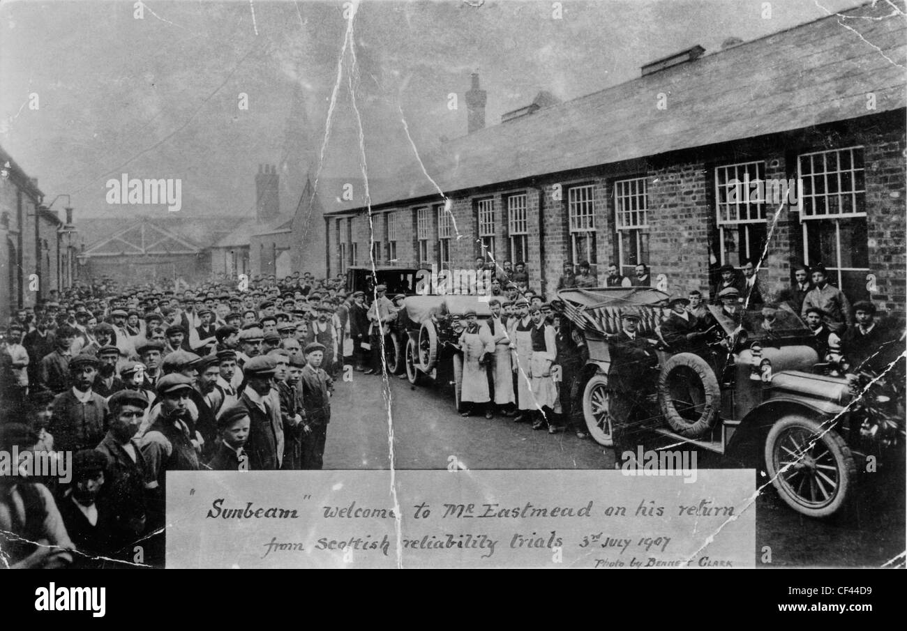 Men from the Sunbeam car works welcoming driver, Fred Eastman, on his return from the Scottish reliability trials, - Stock Image
