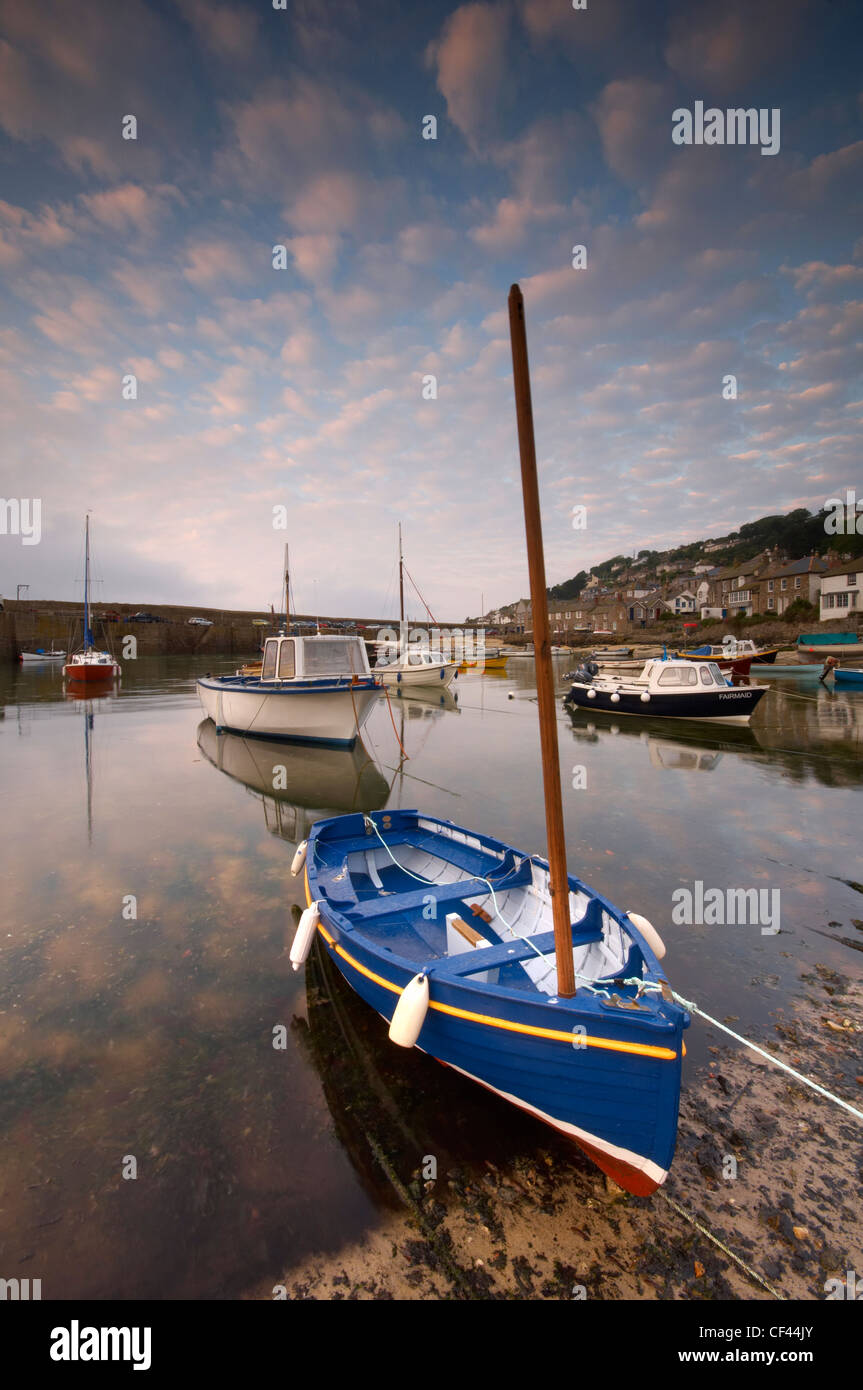 Dawn over the small fishing harbour of Mousehole on the Cornish coastline. - Stock Image