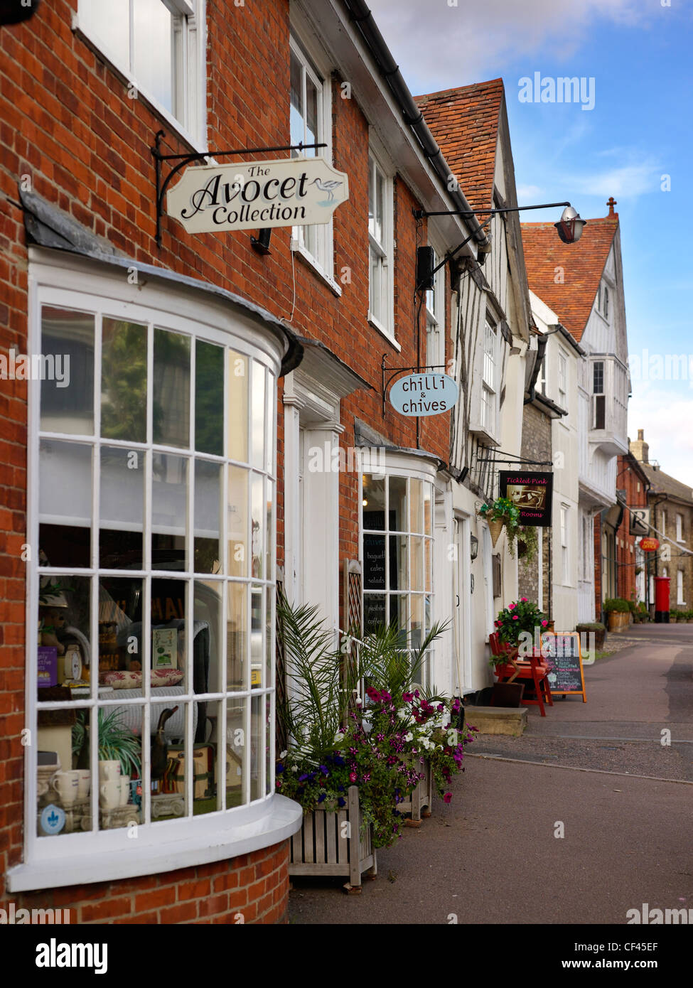 A view of shop fronts in Lavenham. This famous Suffolk village, popular with tourists, was built on the back of - Stock Image