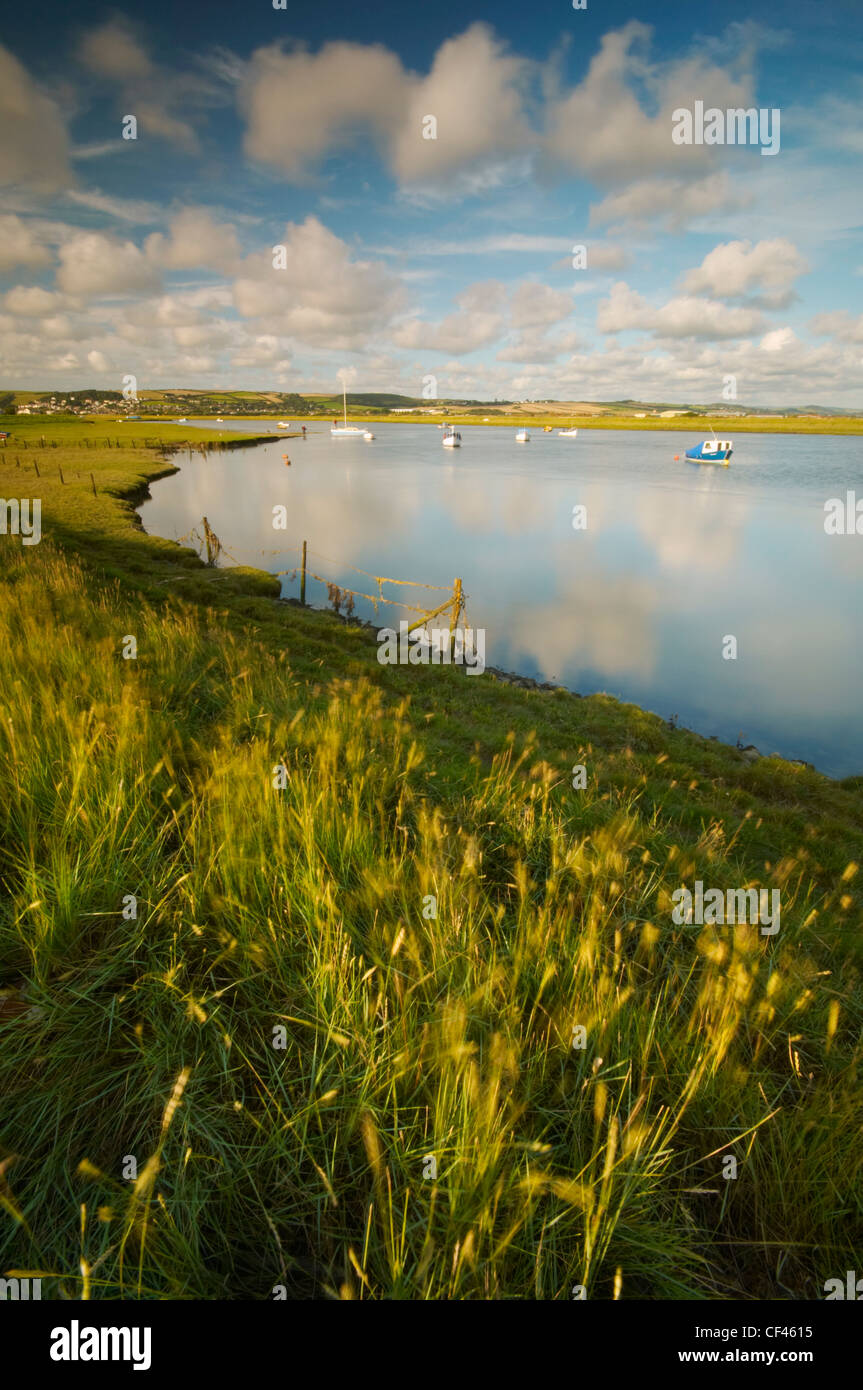 Fishing boats and yachts on the tidal inlet at Braunton Burrows on the North Devon coast. Stock Photo