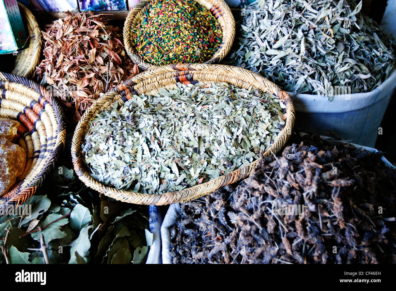 Traditional local herbs and spices in baskets on display outside a shop in Djemaa el-Fna market in Marrakech Morocco Stock Photo