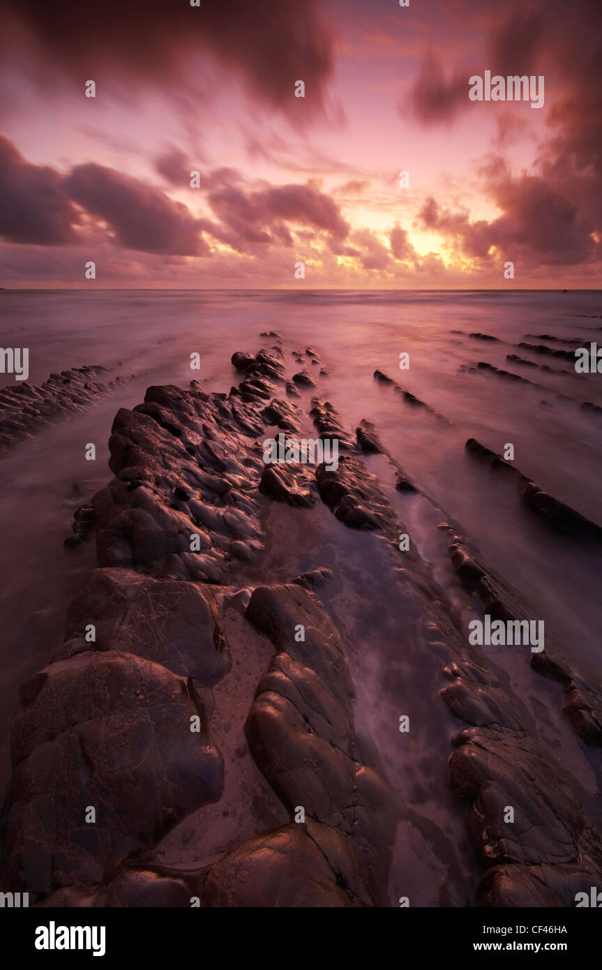 Dramatic sunset over Welcombe Mouth beach on the North Devon coast. Stock Photo
