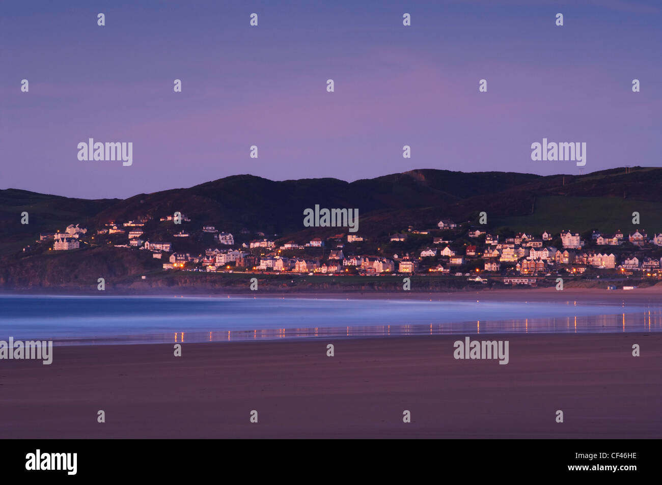 The small seaside resort of Woolacombe at dawn from Putsborough beach on the North Devon coast. - Stock Image