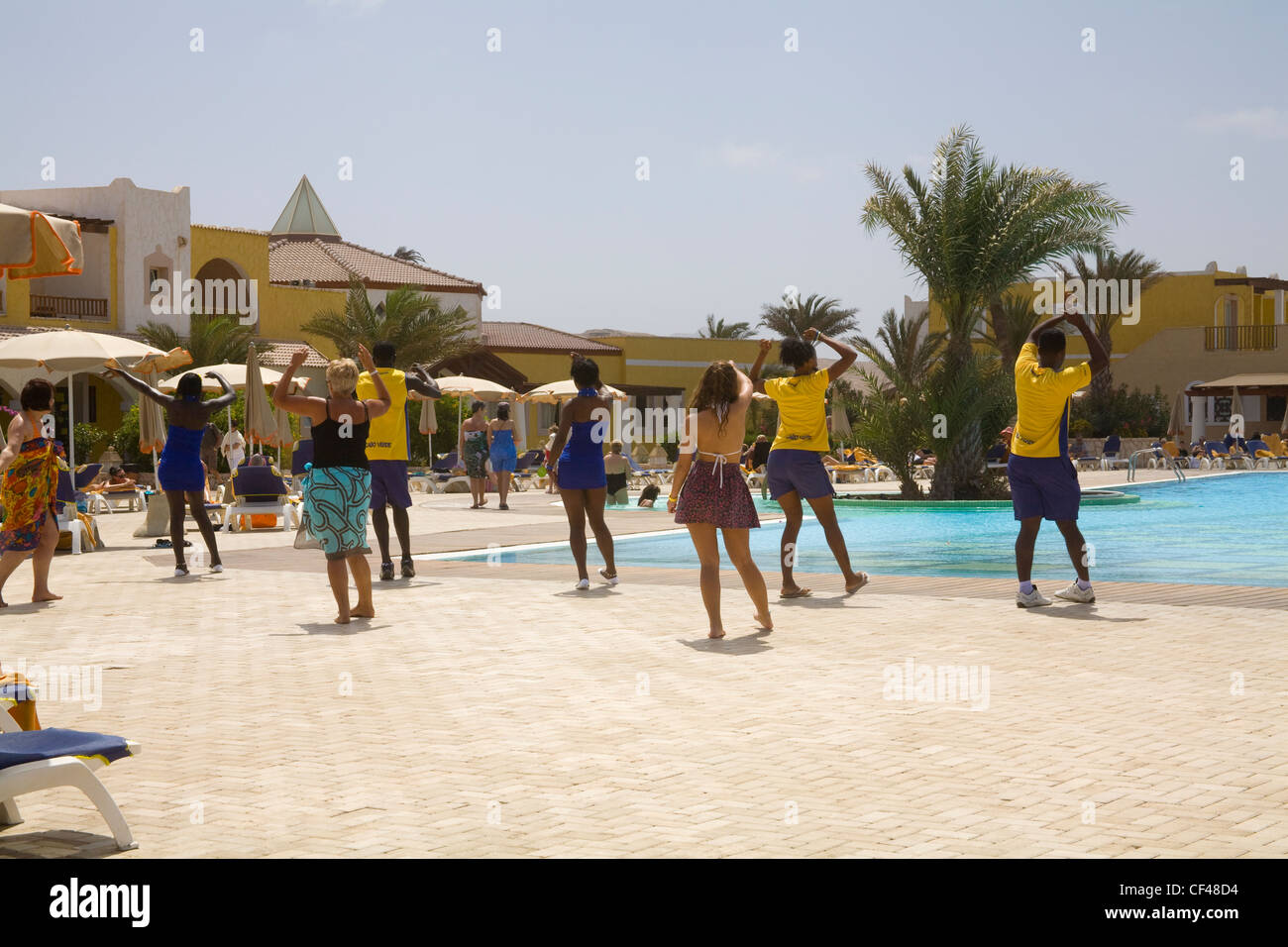 Rabil Boa Vista Cape Verde Islands Hotel entertainers leading a dance class poolside - Stock Image